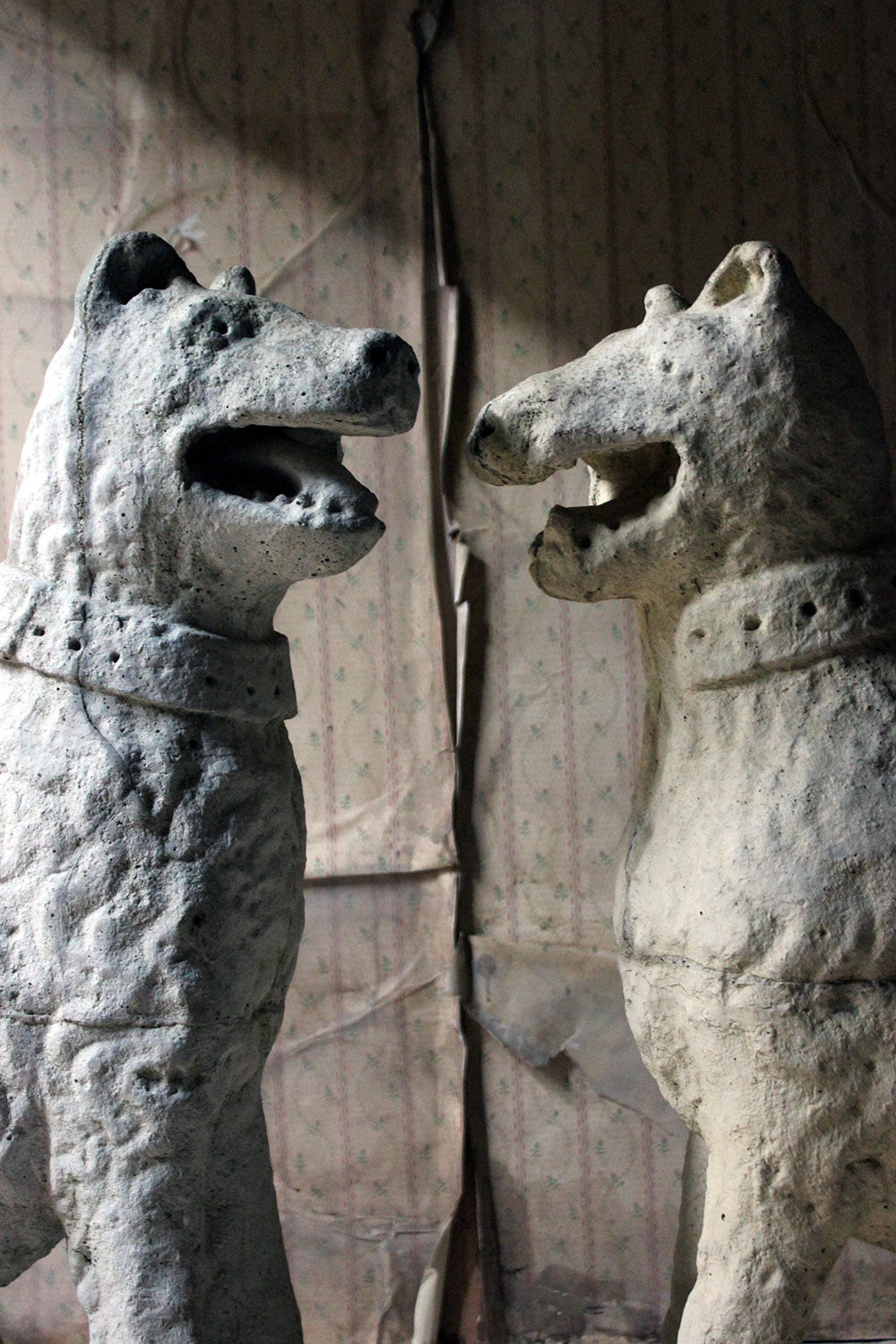 An Imposing Large Pair of 16thC Style Cast Stone Seated Dogs