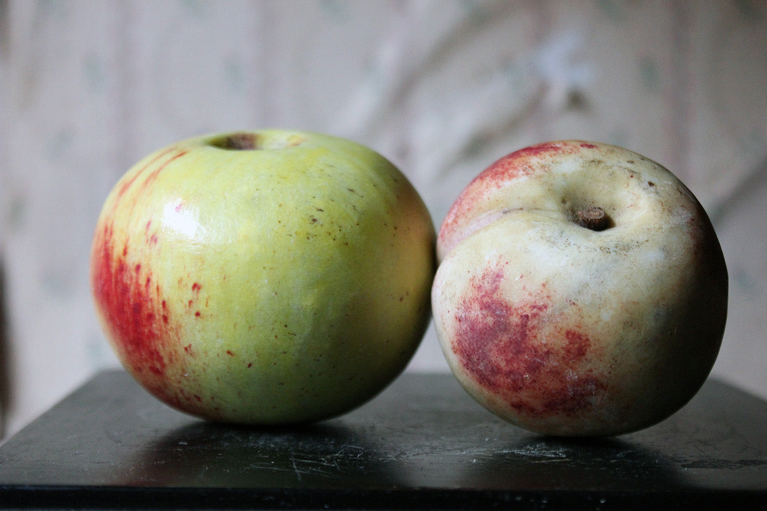 A Pair of Early 20thC Italian Carved Marble Faux Fruits as an Apple & Peach