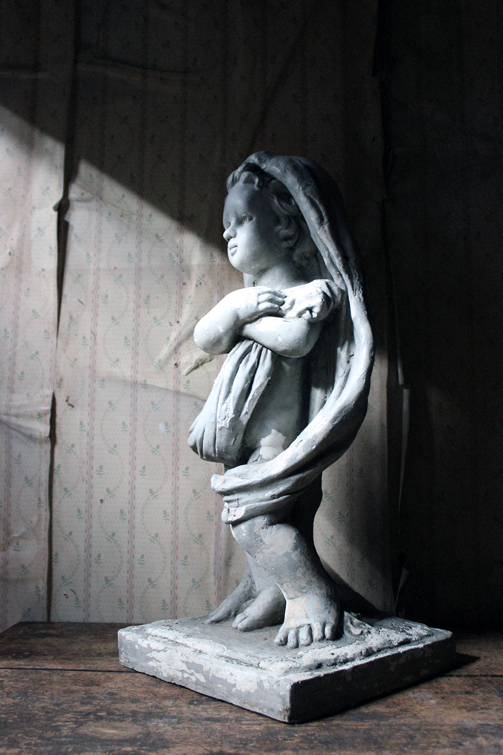 A Painted Plaster Figure of a Putto c.1900