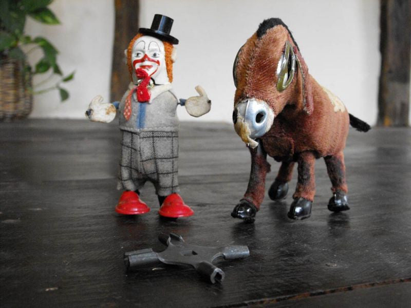 Two pieces of Tin Automata; one a Schuco Clown, One An Unmarked Donkey