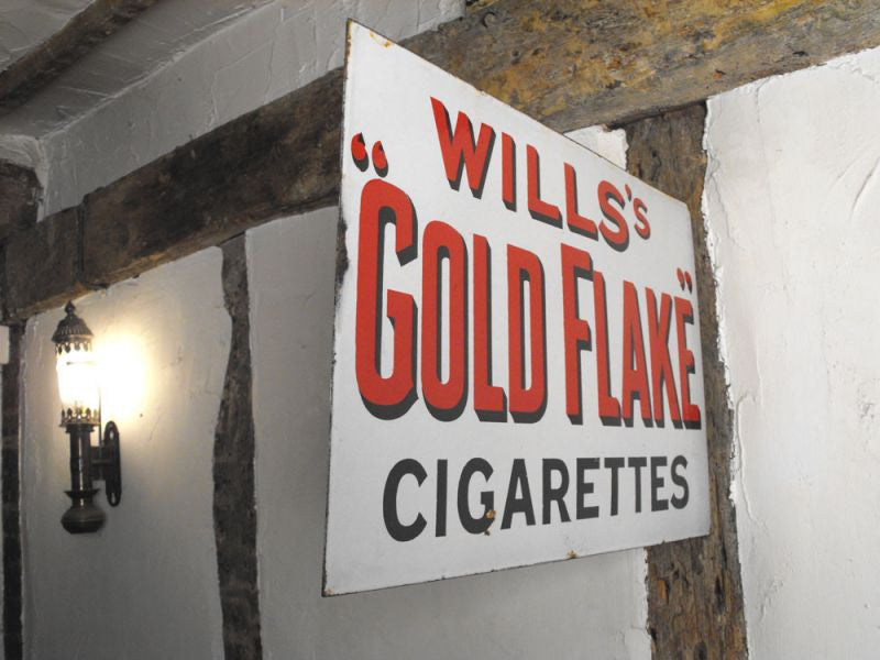 An Early 20thC Advertising Sign for 'Will's Gold Flake Cigarettes'