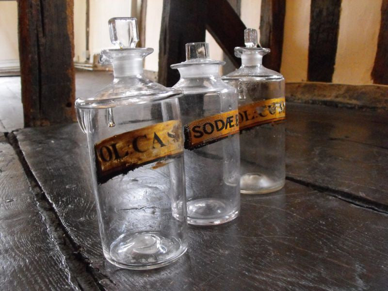 Three Late 19thC Glass Apothecary Bottles with Painted Banners to include Bicarbonate of Soda & two Oleum examples for Cassia & Cumin Oils