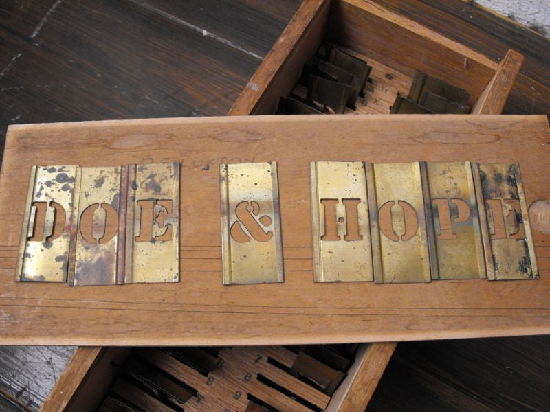 A Handy Boxed Set of ¾ Inch Sized Victorian Brass Stencil Plates