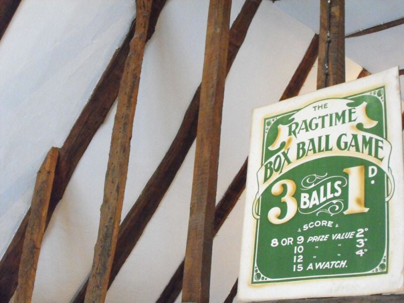 An Original Vintage Fairground Advertising Sign for 'The Ragtime Box Ball Game'