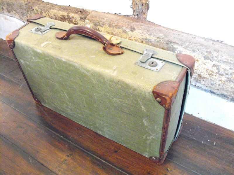 A Modest yet Modish Vintage Leather and Canvas Travel Suitcase
