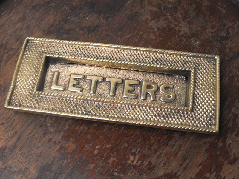 A Smart Art Deco Brass Letterbox