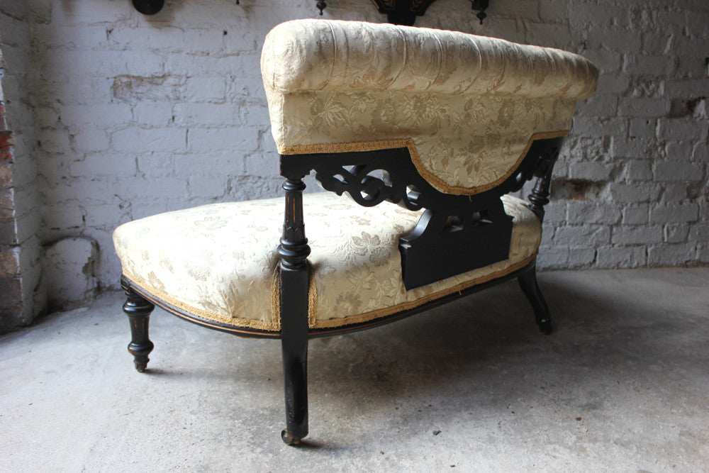 An Elegant Aesthetic Movement Ebonised Upholstered Occasional Settee