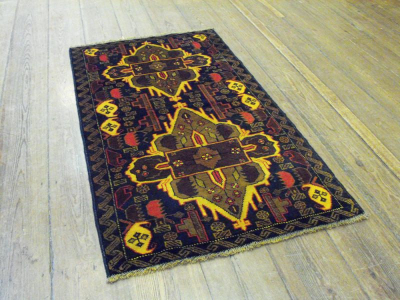 A Striking Herat Belouche Rug: 147cm x 87cm