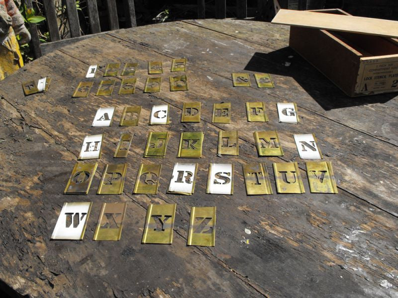 A Versatile Boxed Set of One Inch Sized Victorian Brass Stencil Plates