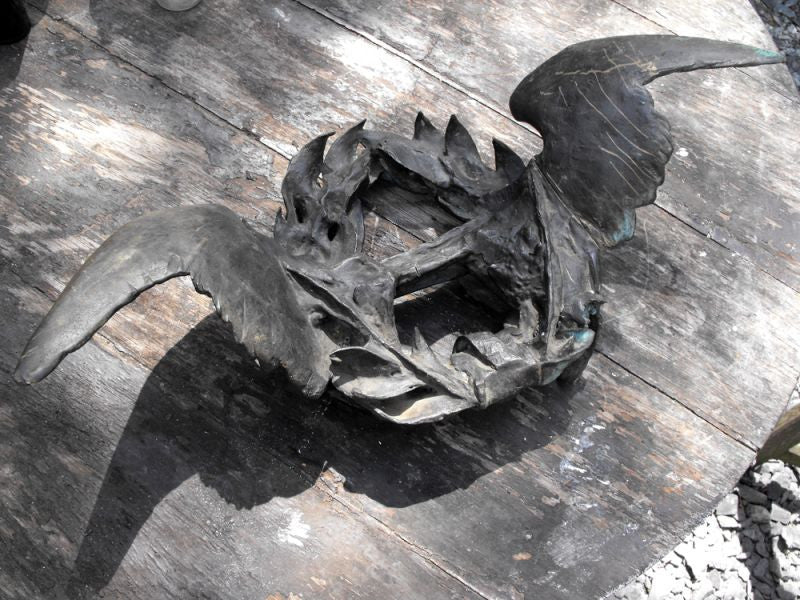 A Unique Cast Bronze Wall Sculpture Formed as a Laurel Wreath Flanked by Spread Wings