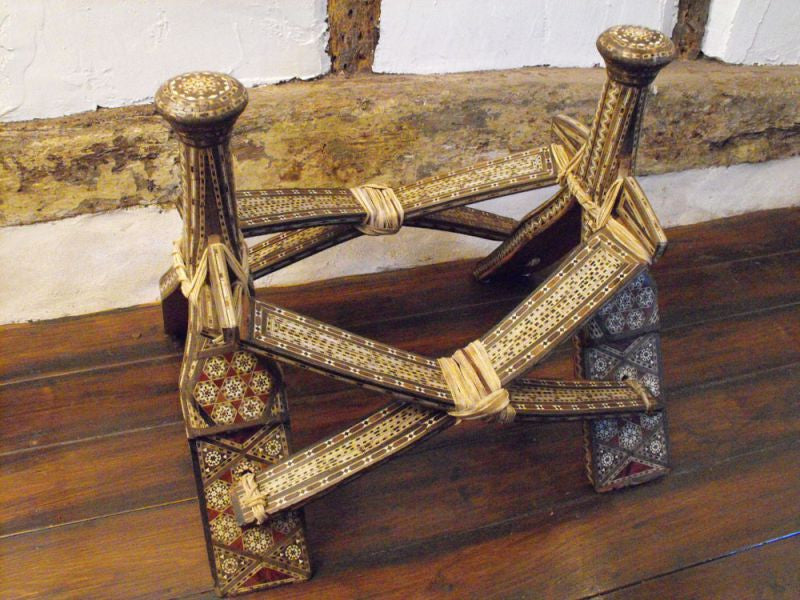 A Moorish Olive Wood & Inlaid Camel Saddle Stool
