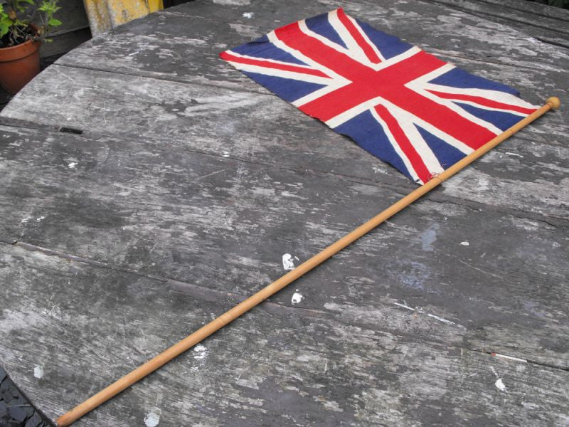 A Mounted British Vintage Printed Union Jack Flag on Pole