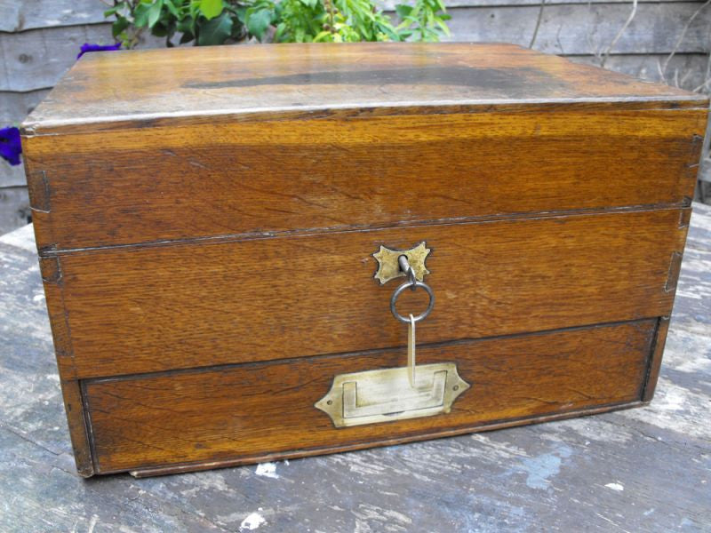 A Good 19thC British Oak Campaign Apothecary Chest to Include Sixty-Seven Bottles