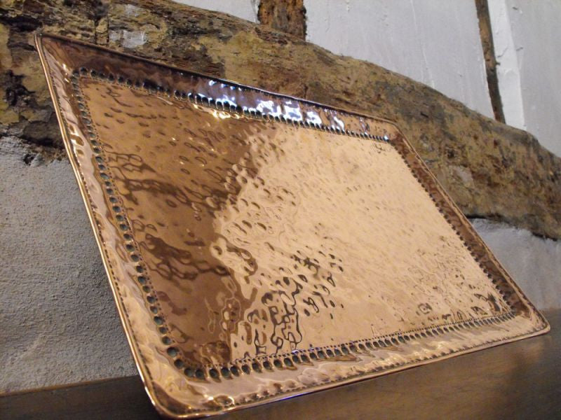 An Arts and Crafts Hammered Copper Tray by John Pearson