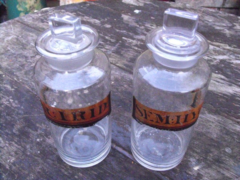 Two Late 19thC Glass Apothecary Bottles with Painted Gold Banners for Hyoscyamus & Iridis