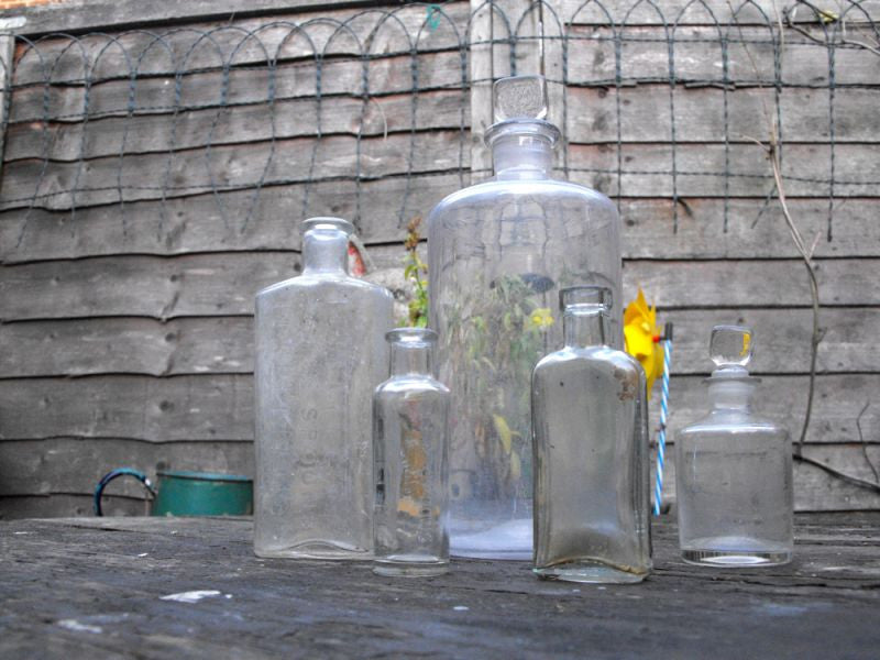 A Mixed Quintet of Late 19thC Plain Glass Apothecary Bottles