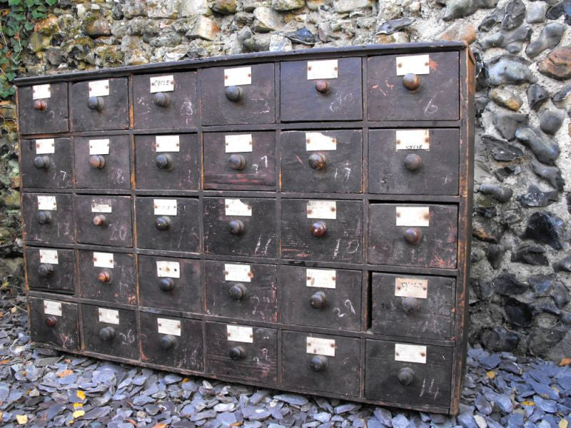 A Highly Sought After Large 19thC Stained Pine Bank of Thirty Drawers
