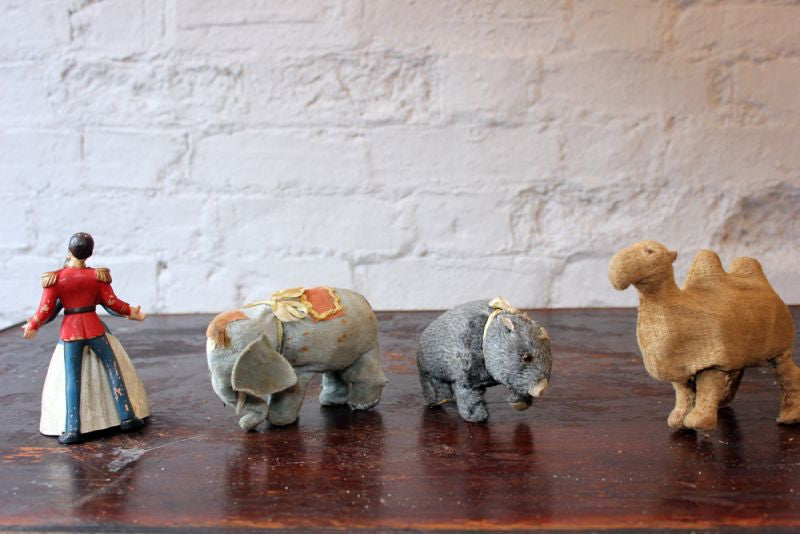 A Charming Group of Four Clockwork Toys to Include a Japanese Camel, Elephant, Bear & British Prince Charming