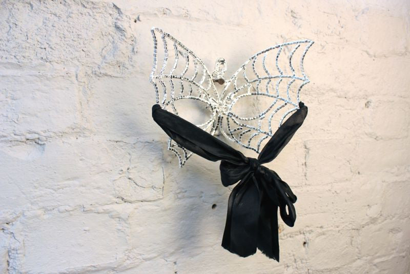 A Good Quality Masquerade Ball Mask in the Form of Butterfly Wings with Skull Decoration