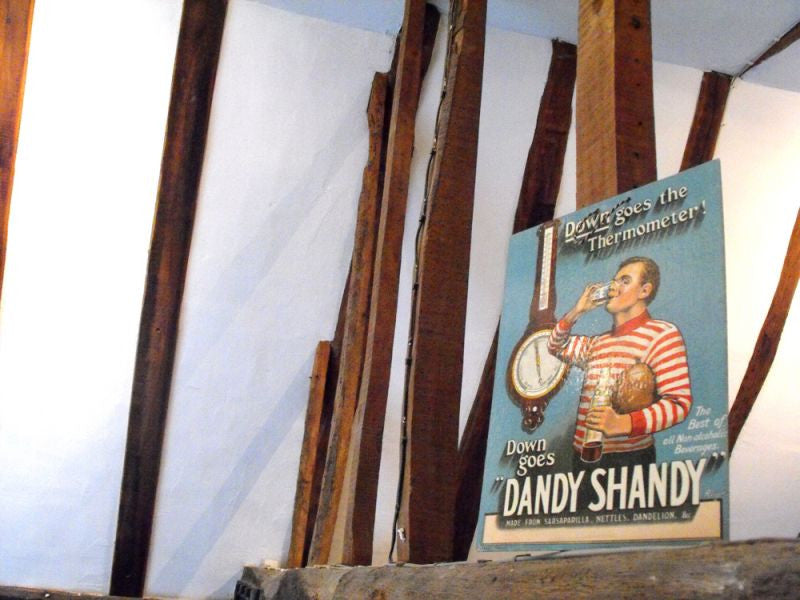 An Early 20thC Chromolithographed Advertising Showcard for 'Dandy Shandy'