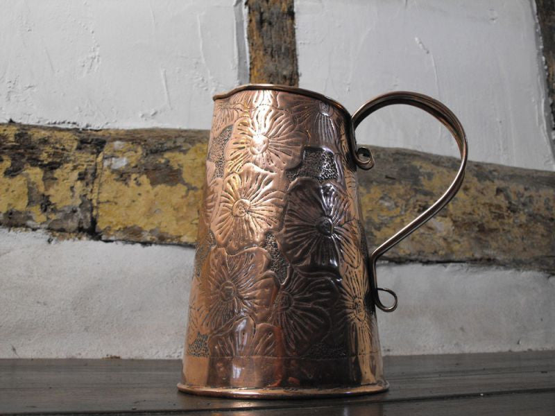 An Arts and Crafts Copper Jug by the Keswick School of Industrial Art