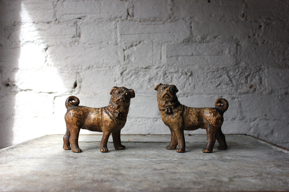 A Whimsical Pair of Early 20thC Gilt Painted Plaster Models of Pug Dogs