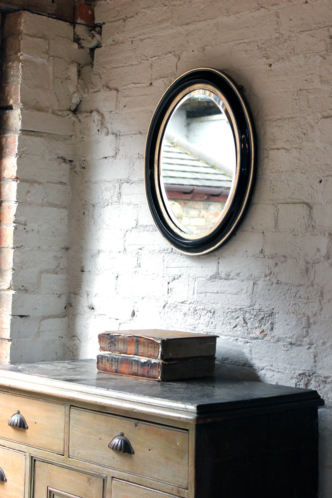A Decorative c.1880 Ebonised Oval Wall Mirror