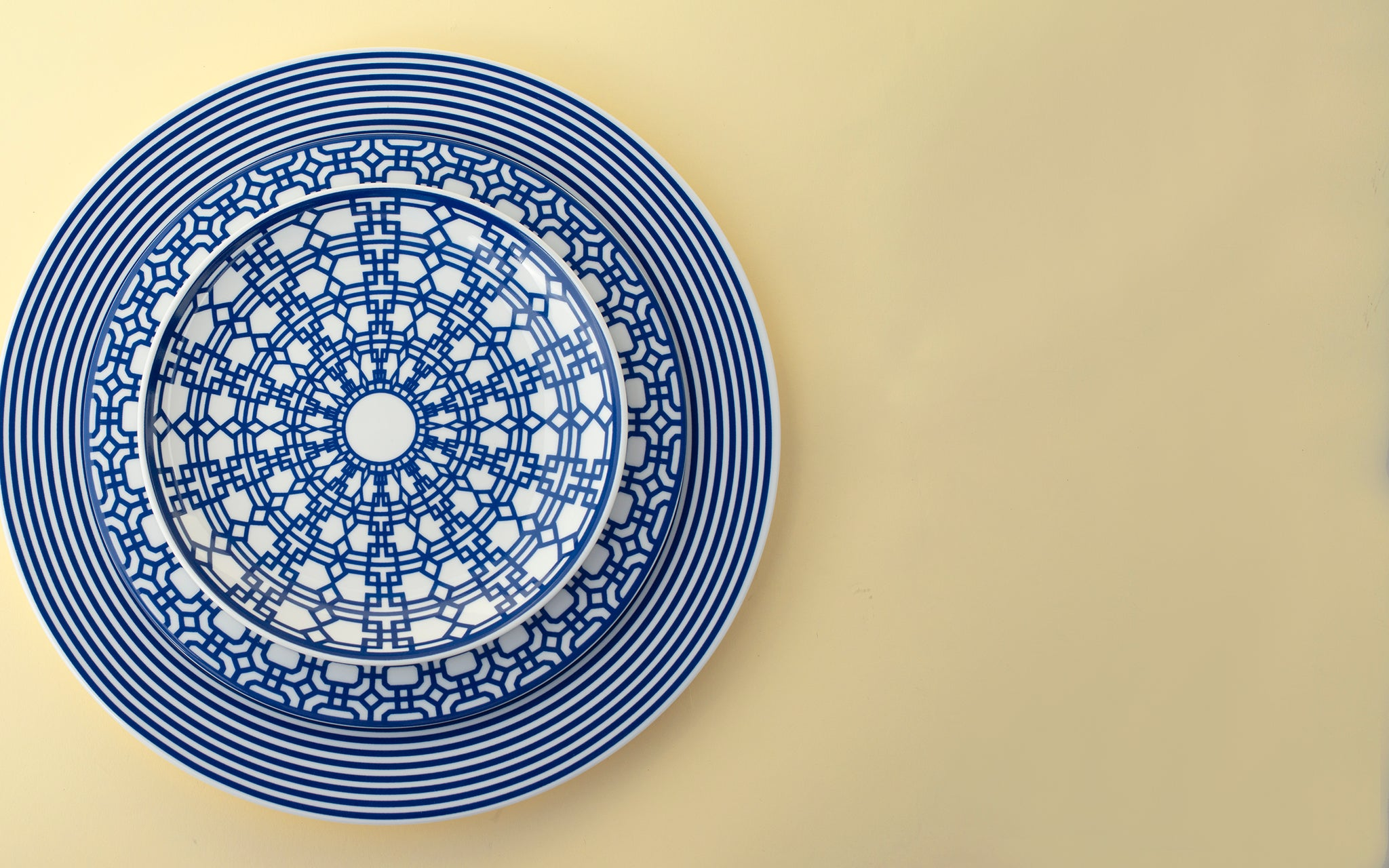 crisp geometric patterns in blue and white on porcelain dinnerware