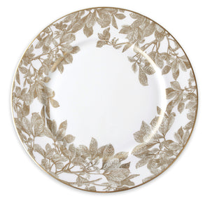 Gold leaves and branches wrap around the rim of this rimmed charger plate.