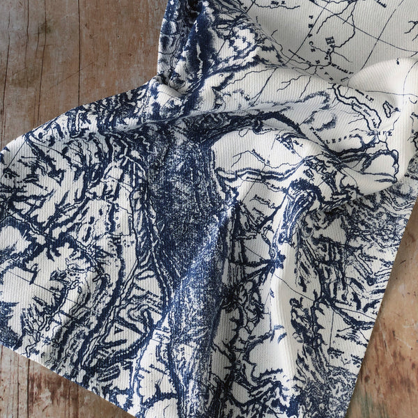 Closeup of Kitchen Towel with Antique Nautical Chart in Blue and White