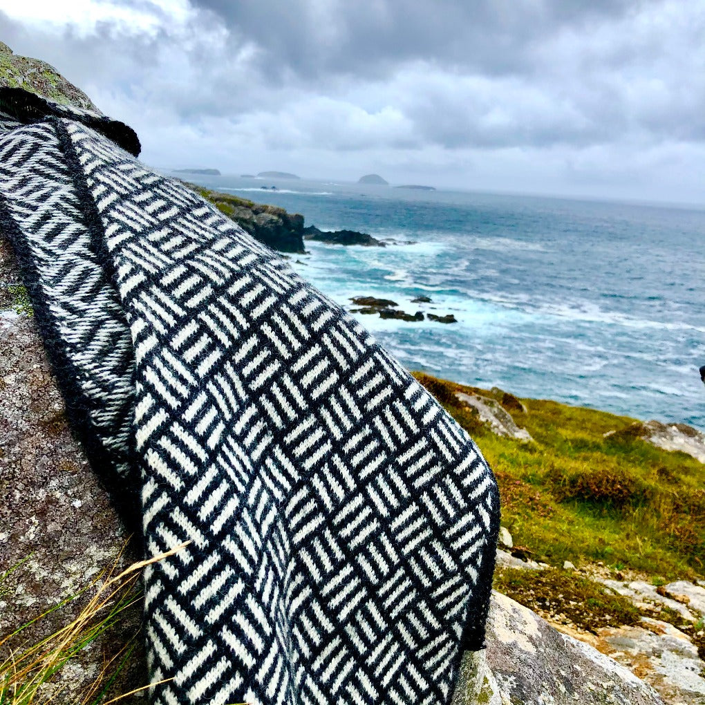 Sashiko Wrap photographed on cliffs shown in Coal & White Rose