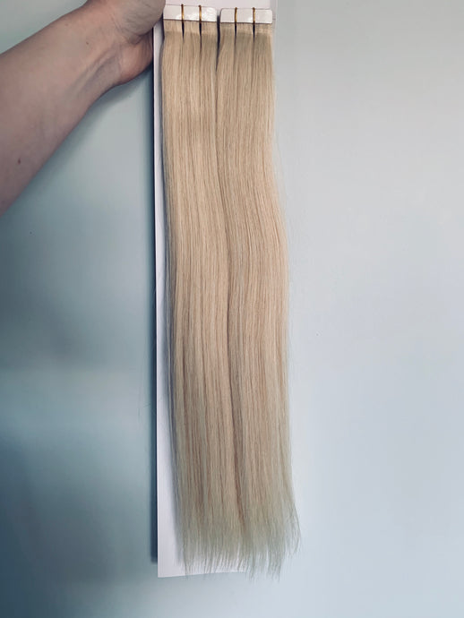 Russian double drawn tape in hair extensions