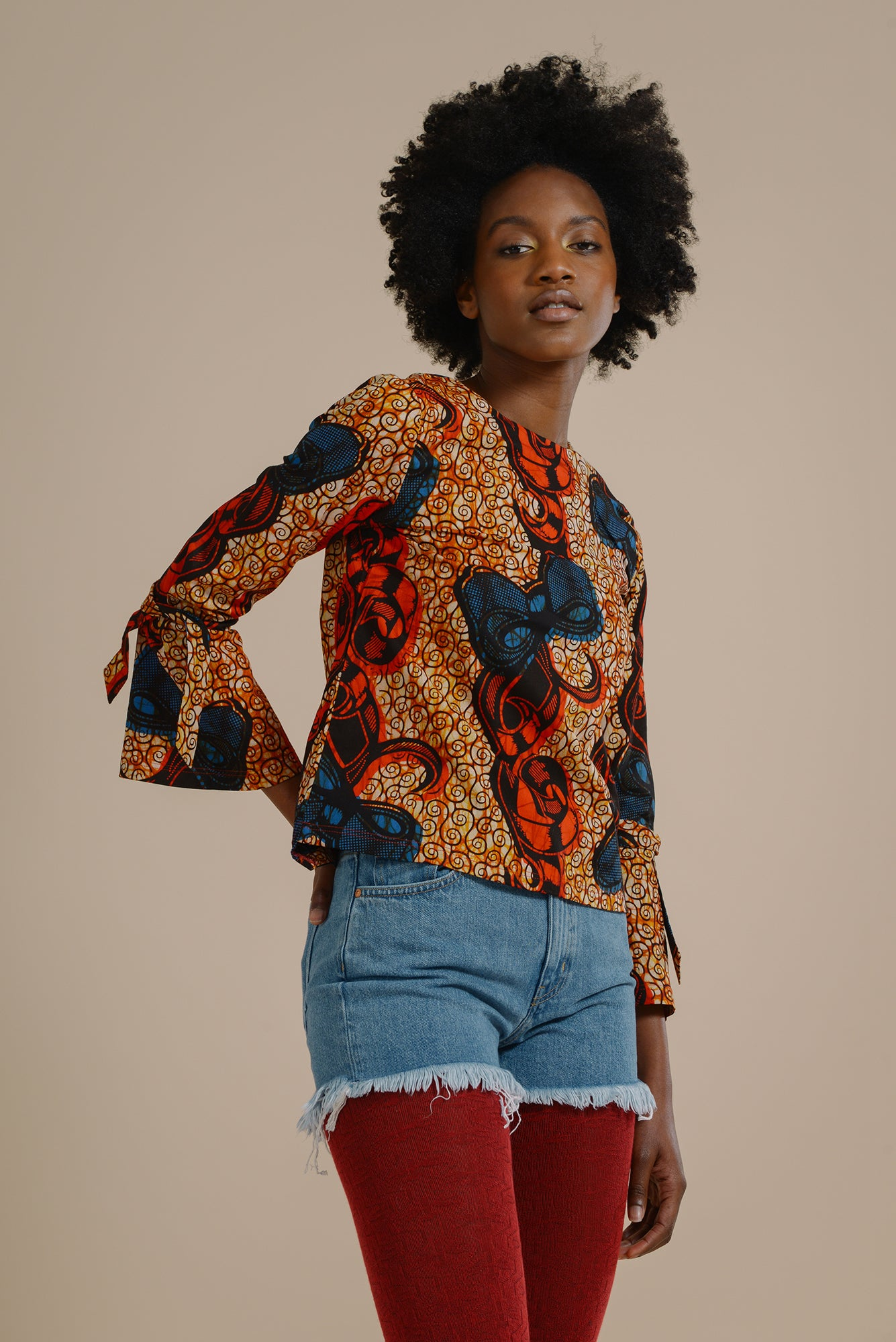 36d6469689bd95 ... Likoma long bell sleeve top with V back in red and blue bow - Mayamiko  Sustainable ...