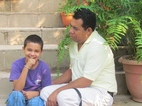 Pastor Carlos Baez of Kids of Cascabel with Little Fanuel