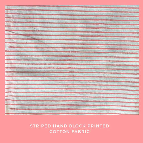 Off white and pink hand block printed fabric