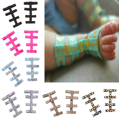 Baby feet wearing stretchy gladiator summer sandals available in 12 different variations