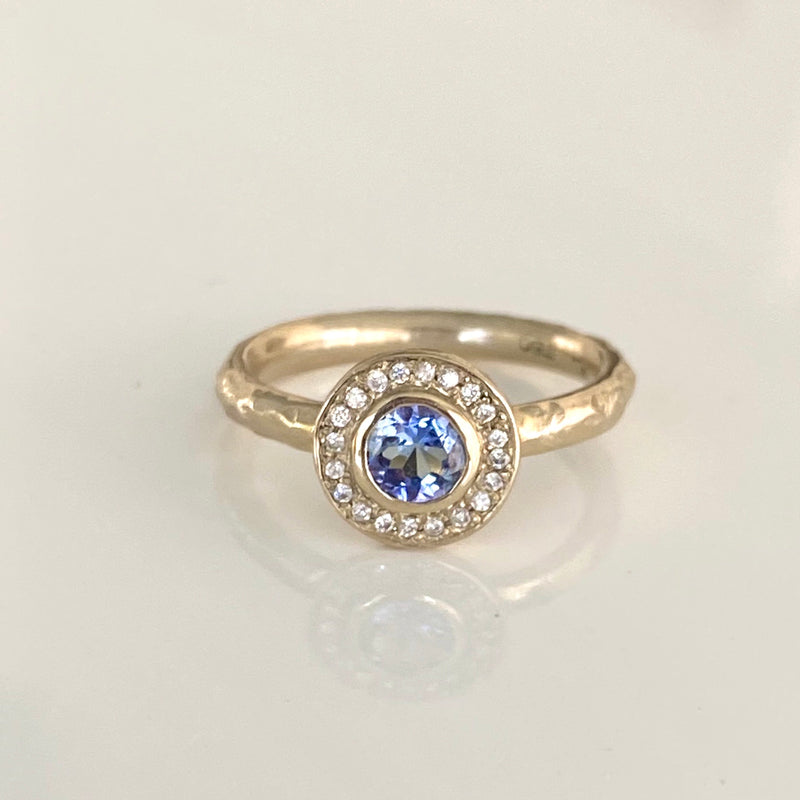 Halo Ring with Blue Sapphire and White Diamonds in 18K White Gold