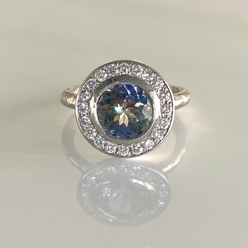 Halo Ring with Tanzanite and White Diamond in Platinum