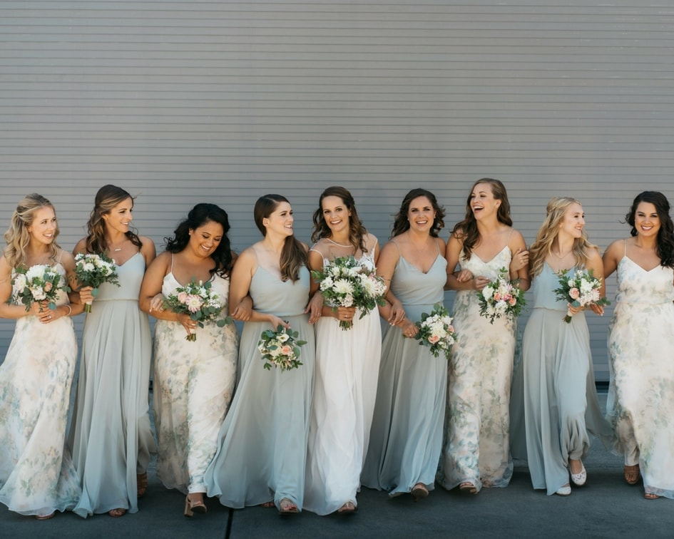 bride with coordinating bridesmaid dresses