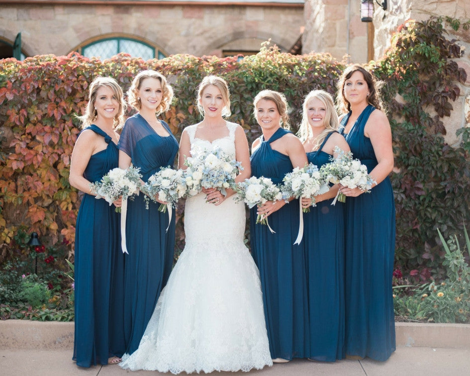 bride in pronovias wedding gown with her bridesmaids