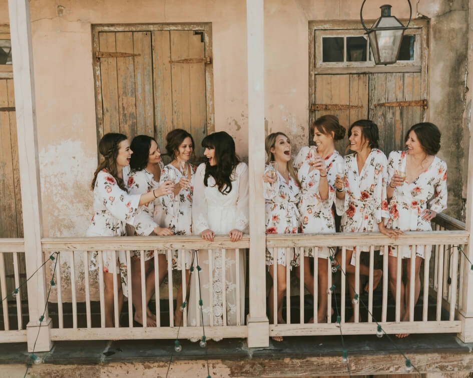 getting ready with the bridesmaids in floral robes