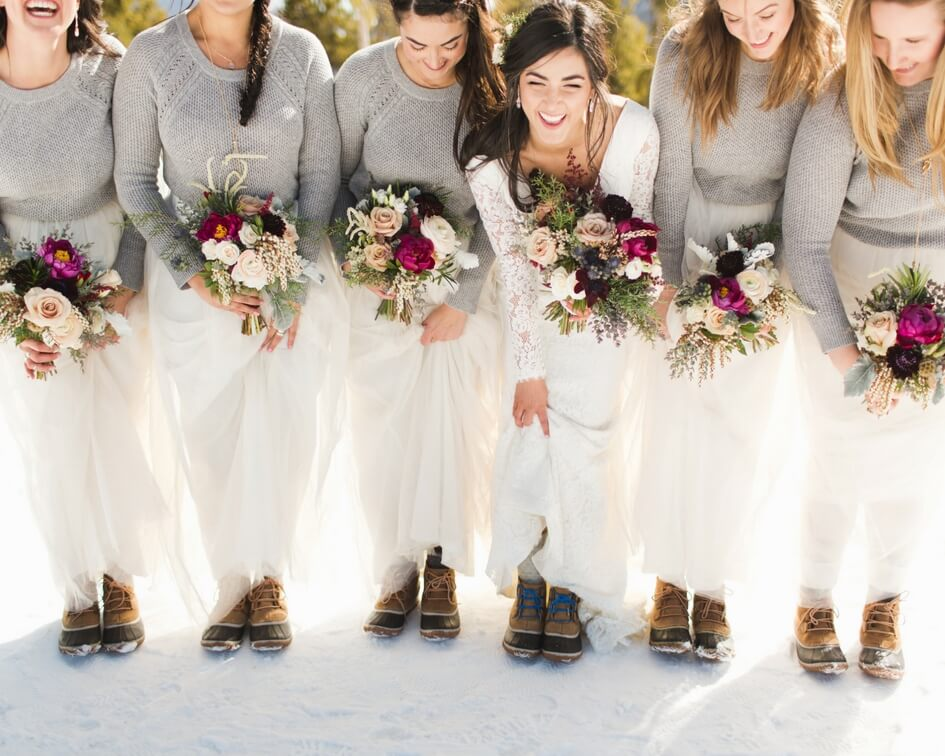 bridesmaids with white skirts and grey sweaters