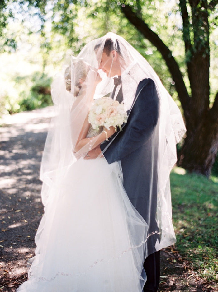 groom and bride wearing Sarah Nouri wedding dress