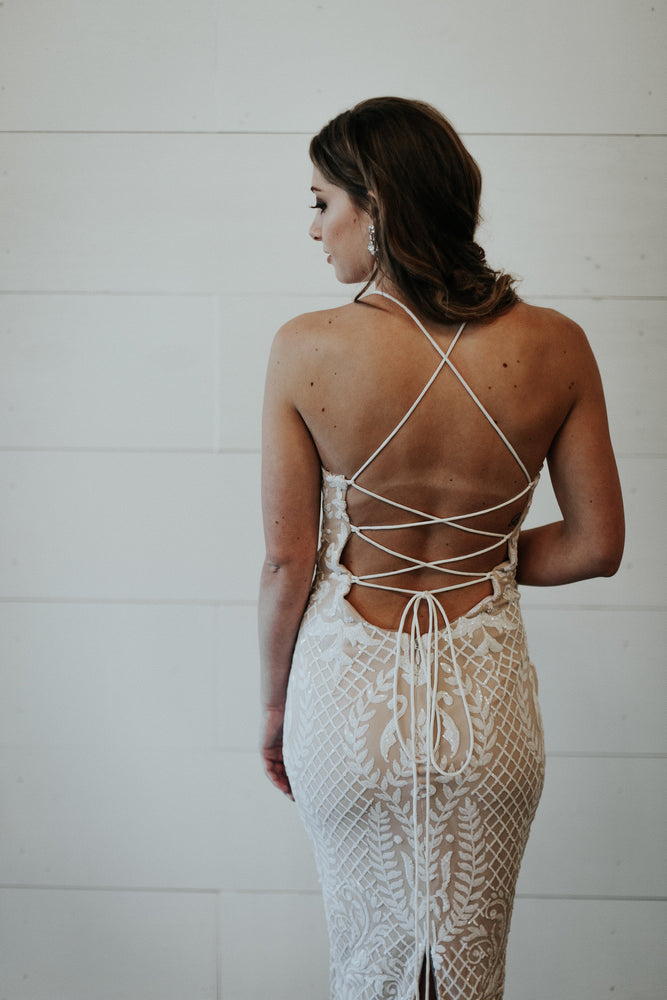 long white and nude beaded dress with tie back