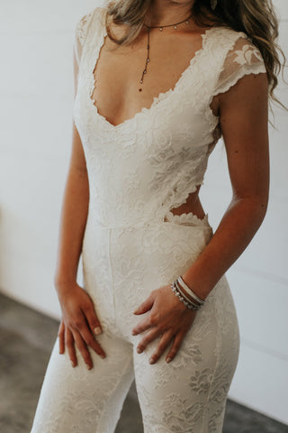 white lace jumpsuit with open back for wedding reception or rehearsal