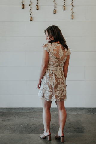 nude and white lace dress