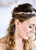 gold crystal chandelier earrings on model