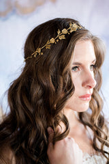 gold floral halo on model