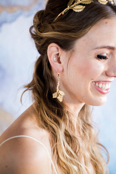 gold leaf earrings on model