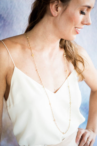 Gold wrap necklace on model